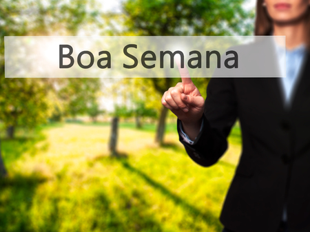 Boa semana (Good Week In portuguese) - Young girl working with virtual screen an touching button. Technology, internet concept. Stock Photo