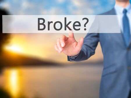 lay off: Broke - Businessman hand touch  button on virtual  screen interface. Business, technology concept. Stock Photo