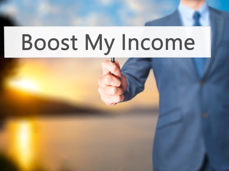 remuneraciones: Boost My Income - Businessman hand holding sign. Business, technology, internet concept. Stock Photo Foto de archivo