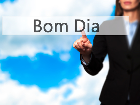 Bom Dia (In portuguese - Good Morning) - Young girl working with virtual screen an touching button. Technology, internet concept. Stock Photo Stock Photo