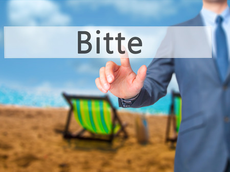 Bitte (Please in German) - Businessman hand touch  button on virtual  screen interface. Business, technology concept. Stock Photo