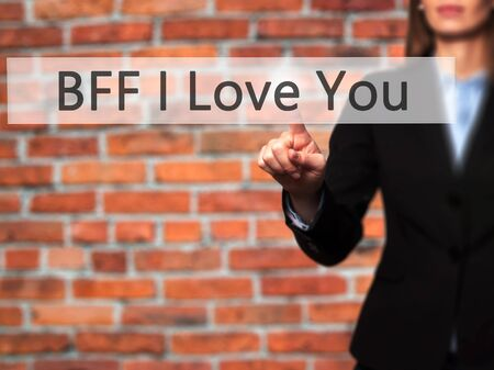 bff: BFF I Love You - Young girl working with virtual screen and touching button. Technology, internet concept. Stock Photo
