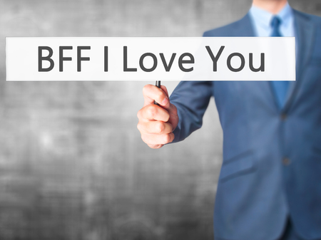 bff: BFF I Love You - Businessman hand holding sign. Business, technology, internet concept. Stock Photo