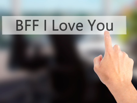 bff: BFF I Love You - Hand pressing a button on blurred background concept . Business, technology, internet concept. Stock Photo