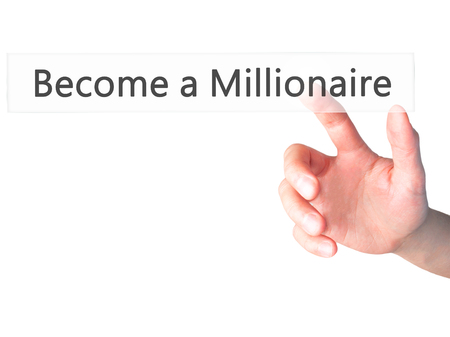 hombre millonario: Become a Millionaire - Hand pressing a button on blurred background concept . Business, technology, internet concept. Stock Photo