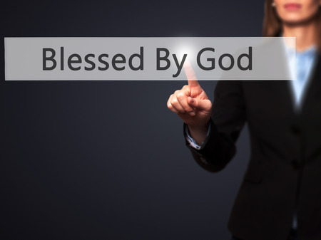 god button: Blessed By God - Young girl working with virtual screen an touching button. Technology, internet concept. Stock Photo