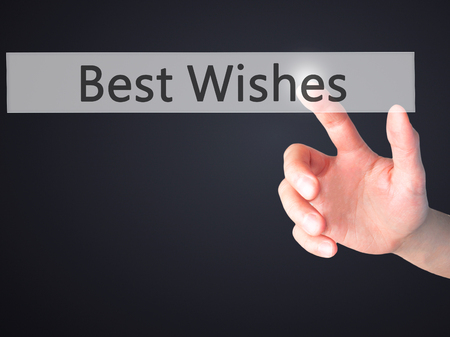 farewell party: Best Wishes - Hand pressing a button on blurred background concept . Business, technology, internet concept. Stock Photo