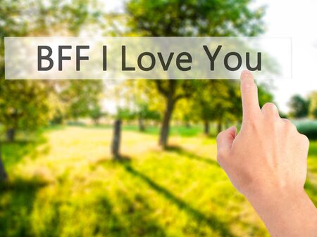 BFF I Love You - Hand pressing a button on blurred background concept . Business, technology, internet concept. Stock Photo