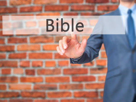 trust god: Bible - Businessman pressing virtual button. Business, technology  concept. Stock Photo Stock Photo