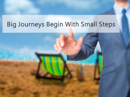 daunting: Big Journeys Begin With Small Steps - Businessman pressing virtual button. Business, technology  concept. Stock Photo