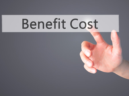 improved: Benefit Cost - Hand pressing a button on blurred background concept . Business, technology, internet concept. Stock Photo