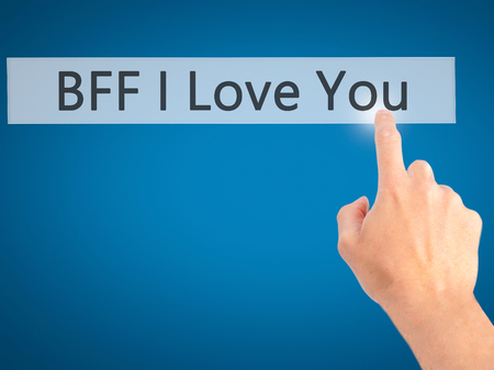 nota: BFF I Love You - Hand pressing a button on blurred background concept . Business, technology, internet concept. Stock Photo