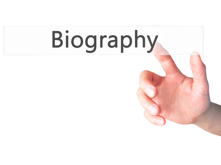 unveil: Biography - Hand pressing a button on blurred background concept . Business, technology, internet concept. Stock Photo