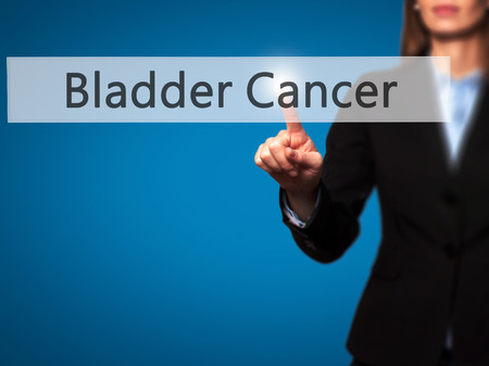 radiation therapy: Bladder Cancer - Young girl working with virtual screen an touching button. Technology, internet concept. Stock Photo