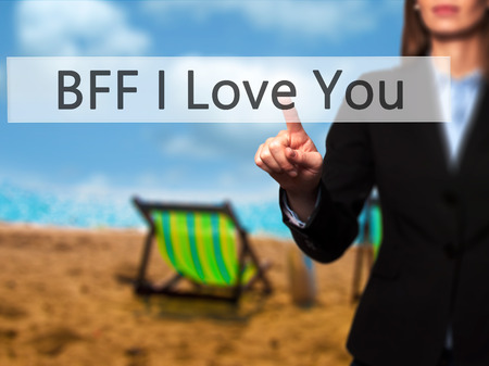 postit note: BFF I Love You - Young girl working with virtual screen and touching button. Technology, internet concept. Stock Photo