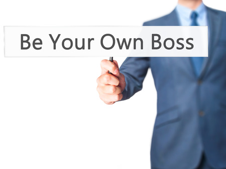 self made: Be Your Own Boss - Businessman hand holding sign. Business, technology, internet concept. Stock Photo Stock Photo