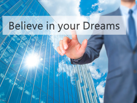 Believe in your Dreams - Businessman hand pushing button on touch screen. Business, technology, internet concept. Stock Image