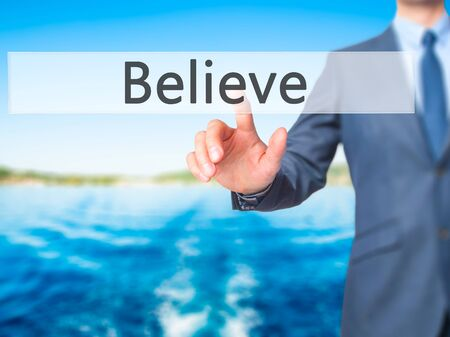 Believe - Businessman hand pushing button on touch screen. Business, technology, internet concept. Stock Image