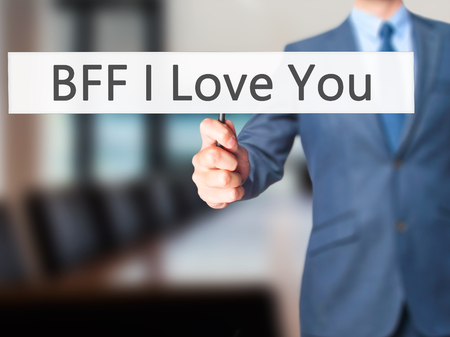 nota: BFF I Love You - Businessman hand holding sign. Business, technology, internet concept. Stock Photo