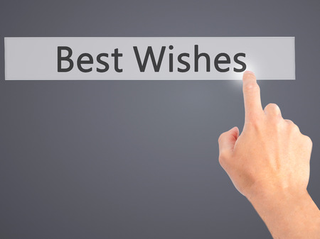 acclaim: Best Wishes - Hand pressing a button on blurred background concept . Business, technology, internet concept. Stock Photo