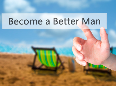 better button: Become a Better Man - Hand pressing a button on blurred background concept . Business, technology, internet concept. Stock Photo