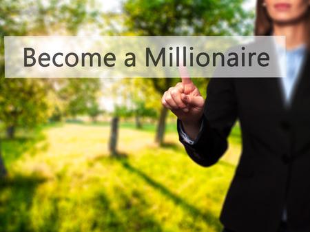 hombre millonario: Hacerse Millonario - El éxito de negocios haciendo uso de tecnologías innovadoras y la presión del botón dedo. Negocio, el futuro y el concepto de tecnología. Foto de stock Foto de archivo