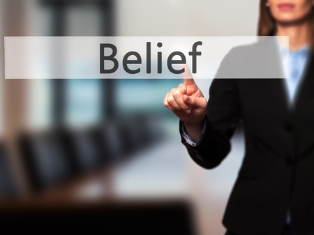 posit: Belief -  Successful businesswoman making use of innovative technologies and finger pressing button. Business, future and technology concept. Stock Photo