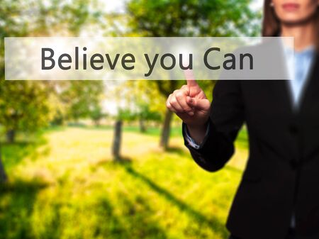 Believe you Can -  Successful businesswoman making use of innovative technologies and finger pressing button. Business, future and technology concept. Stock Photo