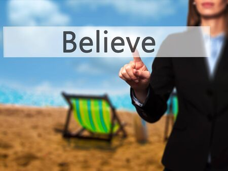Believe -  Successful businesswoman making use of innovative technologies and finger pressing button. Business, future and technology concept. Stock Photo