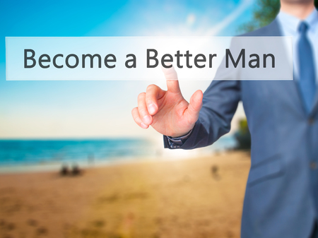 better button: Become a Better Man - Businessman hand pushing button on touch screen. Business, technology, internet concept. Stock Image Stock Photo