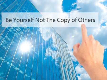 Be Yourself Not The Copy of Others - Hand pressing a button on blurred background concept . Business, technology, internet concept. Stock Photo Stock Photo
