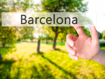 Barcelona - Hand pressing a button on blurred background concept . Business, technology, internet concept. Stock Photo