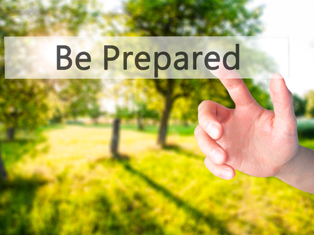 Be Prepared - Hand pressing a button on blurred background concept . Business, technology, internet concept. Stock Photo Stock Photo