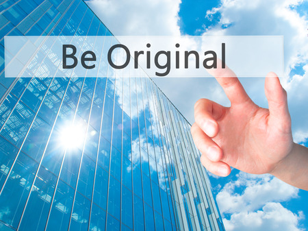 Be Original - Hand pressing a button on blurred background concept . Business, technology, internet concept. Stock Photo