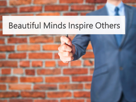 others: Beautiful Minds Inspire Others - Business man showing sign. Business, technology, internet concept. Stock Photo