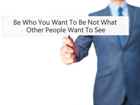 counsel: Be Who You Want To Be Not What Other People Want To See - Business man showing sign. Business, technology, internet concept. Stock Photo