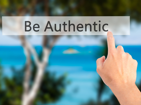 straightforward: Be Authentic - Hand pressing a button on blurred background concept . Business, technology, internet concept. Stock Photo Stock Photo