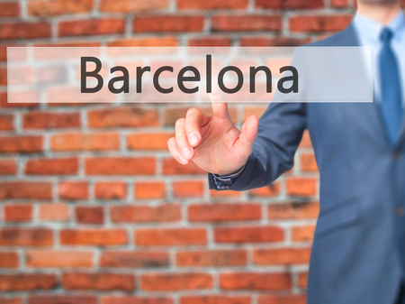 Barcelona - Businessman hand pressing button on touch screen interface. Business, technology, internet concept. Stock Photo
