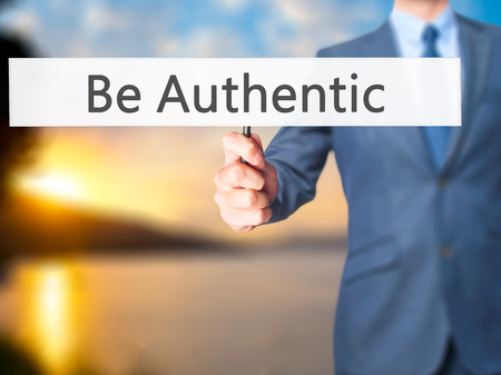 faked: Be Authentic - Business man showing sign. Business, technology, internet concept. Stock Photo