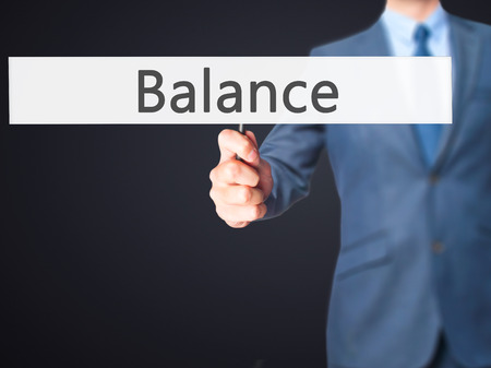 sense of security: Balance - Business man showing sign. Business, technology, internet concept. Stock Photo