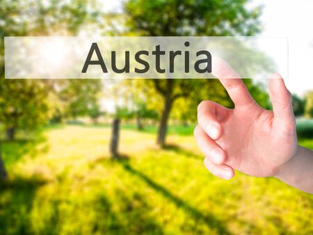 linz: Austria - Hand pressing a button on blurred background concept . Business, technology, internet concept. Stock Photo