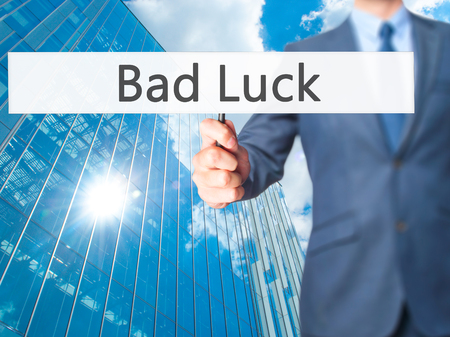 motivator: Bad Luck - Business man showing sign. Business, technology, internet concept. Stock Photo