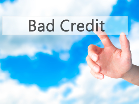 customer records: Bad Credit - Hand pressing a button on blurred background concept . Business, technology, internet concept. Stock Photo