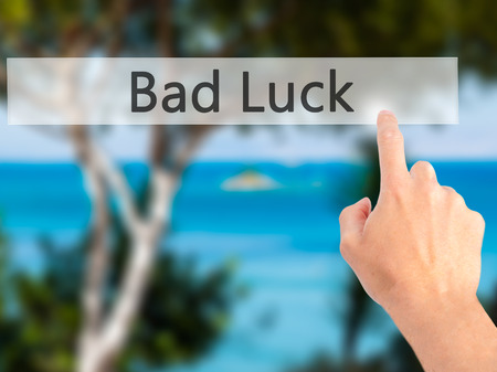 personal perspective: Bad Luck - Hand pressing a button on blurred background concept . Business, technology, internet concept. Stock Photo