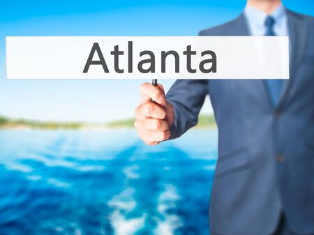 atlanta tourism: Atlanta - Business man showing sign. Business, technology, internet concept. Stock Photo