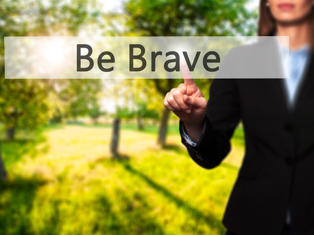 Be Brave -  Female touching virtual button. Business, internet concept. Stock Photo Stock Photo