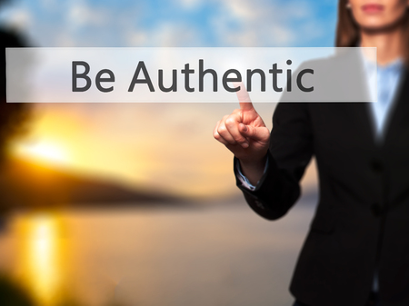 straightforward: Be Authentic -  Female touching virtual button. Business, internet concept. Stock Photo
