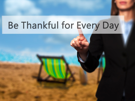 Be Thankful for Every Day -  Female touching virtual button. Business, internet concept. Stock Photo Stock Photo