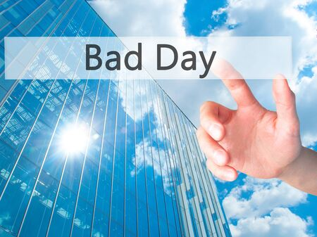 Bad Day - Hand pressing a button on blurred background concept . Business, technology, internet concept. Stock Photo