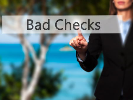 swindle: Bad Checks - Businesswoman hand pressing button on touch screen interface. Business, technology, internet concept. Stock Photo Stock Photo